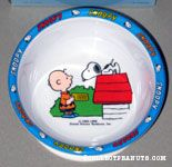 Charlie Brown feeding Snoopy on Doghouse Suction Bowl