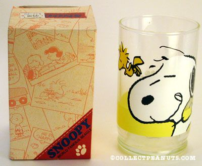 Snoopy licking his lips with Woodstock Glass