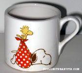 Woodstock carrying Snoopy in blanket as a stork Mug