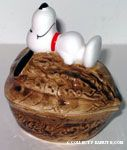 Snoopy laying on top of Walnut Nut Dish