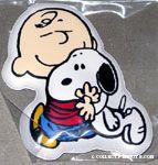 Charlie Brown hugging Snoopy Magnet