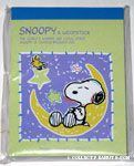 Snoopy sleeping on Moon Notepad