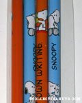 Snoopy holding paper set of 4 pencils