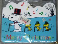 Snoopy and Woodstocks dancing with candy canes in snow Wooden Ornament