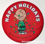 Charlie Brown tangled in lights 'Happy Holidays' Fabric-covered Button