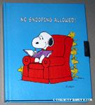Snoopy sitting in armchair with Woodstocks 'No Snooping Allowed' Diary