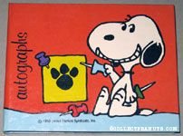 Snoopy holding push pins Autograph Book