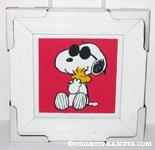 Joe Cool hugging Woodstock Framed Print