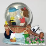 Charlie Brown and Heather holding hands on pier Snowglobe