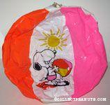 Snoopy holding dripping beach ball under the sun Beach Ball
