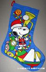 Santa Snoopy standing with toys Stocking