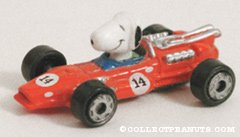 Snoopy in tiny red race car