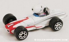 Snoopy in tiny white & red race car