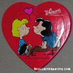 Lucy smiling at Schroeder on top of his piano Valentine's Heart-shaped Candy