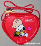 Charlie Brown hugging Snoopy Valentine's Heart-shaped Candy Box in Purse