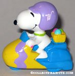 Snoopy riding scooter Easter PVC Figurine