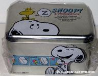 Woodstock sleeping on Snoopy's head Tin