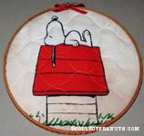 Snoopy on doghouse Fabric in Hoop