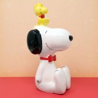 Snoopy sitting with Woodstock on head Bank