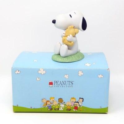 Snoopy hugging Woodstock Figurine
