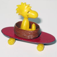 Woodstock in nest on Skateboard