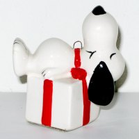 Snoopy laying on gift package Christmas Ornament