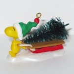 Woodstock with Tree on Sled Christmas Ornament