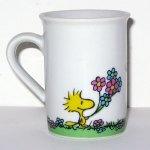 Woodstock giving Snoopy Flowers Mug Vase