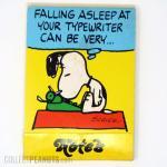 Snoopy asleep at typewriter notebook