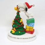 Snoopy and Woodstock Trimming Christmas Tree Figurine