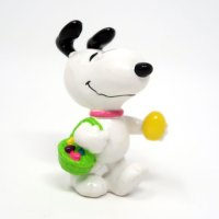 Snoopy with green basket of Easter eggs PVC Figurine