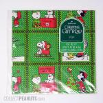 Peanuts Christmas Scenes with Holly Border Gift Wrap