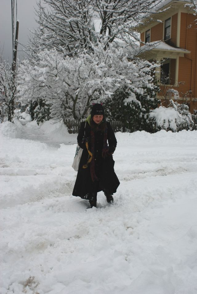 Me in cat hat on my very snow street.