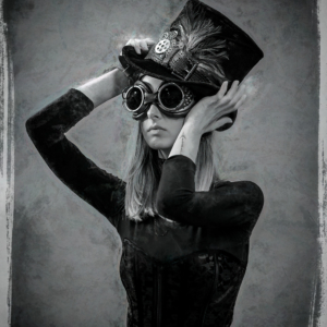 Girl in Steampunk clothing with large aviator goggle, high hat with plumage