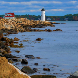 Lighthouse at the point of a rocky inlet in Maine