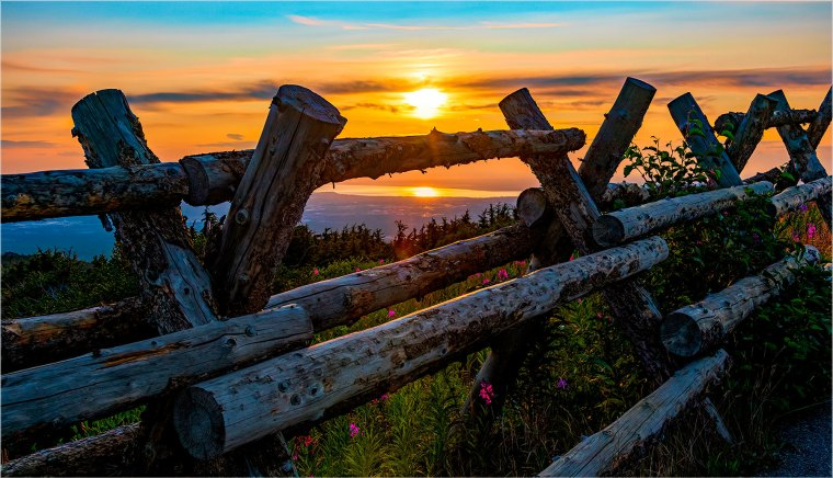 Old-style fence along the ridge of Flattop Mountain at sunset overlooking Anchorage, Alaska