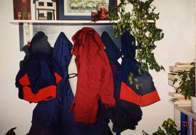 Jedd's coat, matching Justin's, a Christmas gift from grandparents, hung waiting in January, 2001.