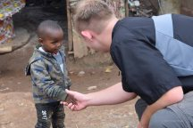 My son, Jacob, greeting a Mathare child.