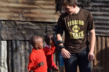 """My son Justin. The kids of Mathare called his arm a """"robot"""" arm."""