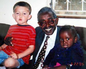 Justin and Lily with Pastor Karau, 2005