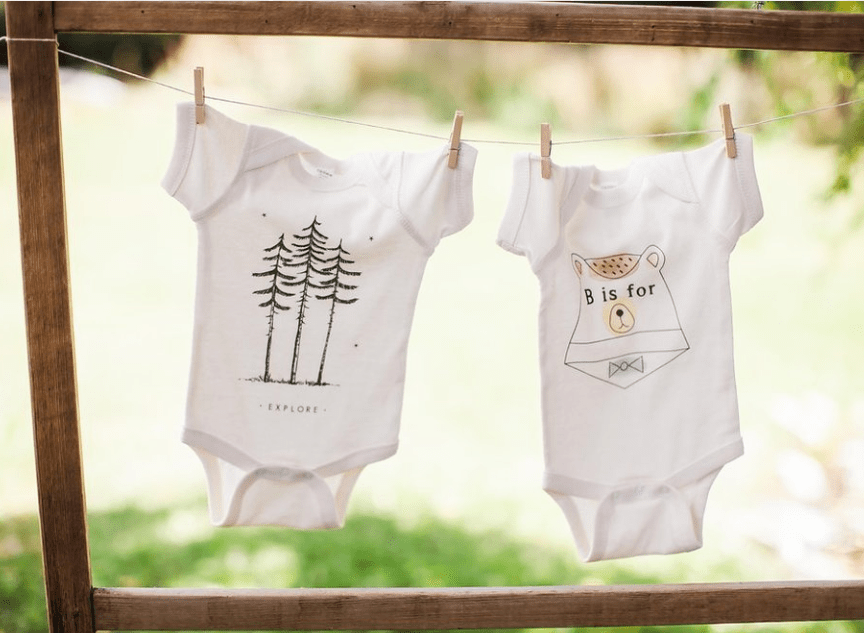 Onesies decor for adventure themed baby shower