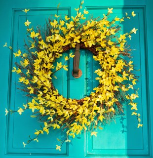 yellow floral wreath turquoise front door