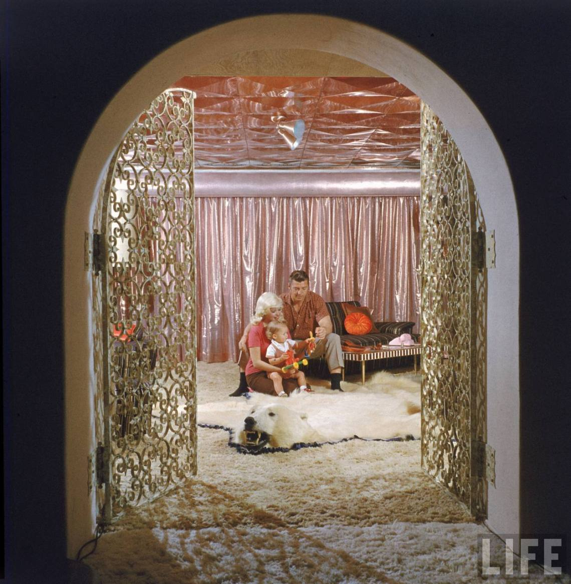 Jayne Mansfield's Pink Palace | Jayne Mansfield and her family with a polar bear rug.