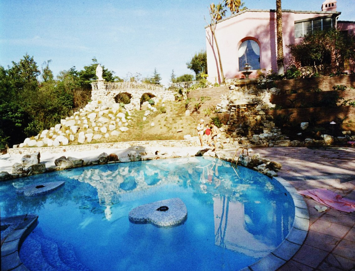 Jayne Mansfield's Pink Palace | The heart-shaped pool with the pink palace in the background.