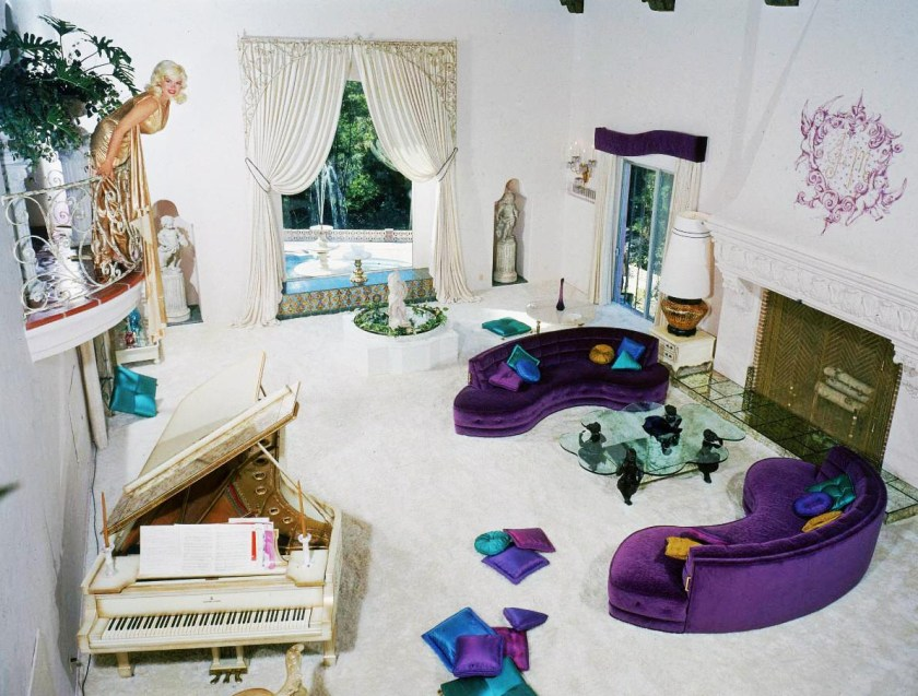 Jayne Mansfield's Pink Palace | Jayne shows off her fancy living room while wearing a gold gown.
