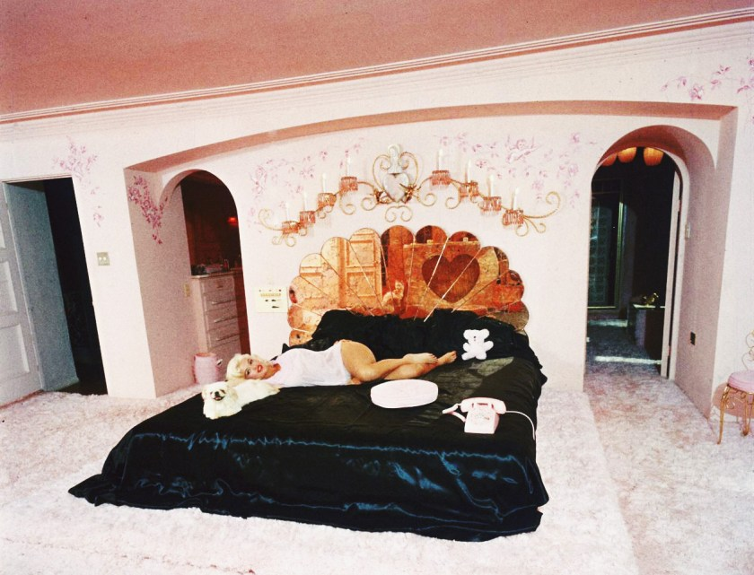 Jayne Mansfield's Pink Palace | Jayne chills with her dog on her black satin bed.