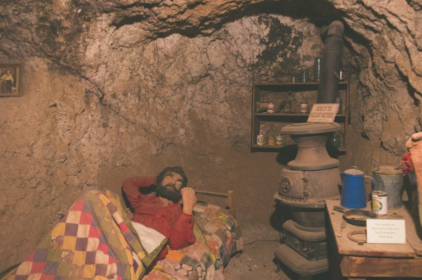 A creepy mannequin sleeping with one eye open at Calico Ghost Town | ColleenWelsch.com