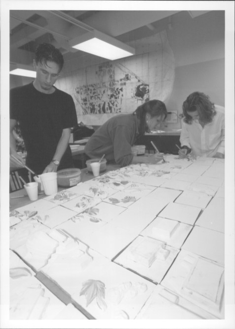 Art students work on tiles for the architectural bas relief ceramic mural 1998