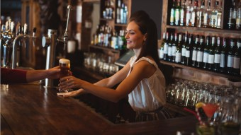 Bar Sign Reminds Customers That Female Bartenders Aren't Flirting With Them