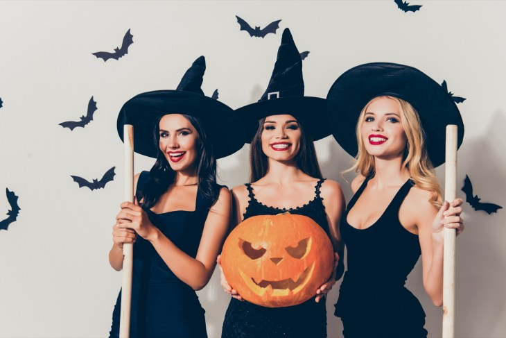 Three girls dressed up as witches for Halloween